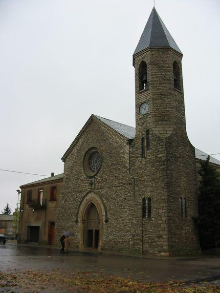 '.. La modernitat del poble explica aquesta església singular amb un campanar de pissarra, únic a la Segarra.' - Sant Guim de Freixenet